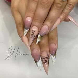 Stiletto Nails and White Tips with Artistic Design
