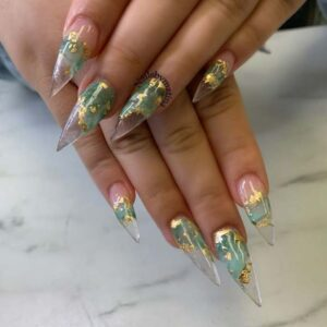 Stiletto nails with olive and gold foil