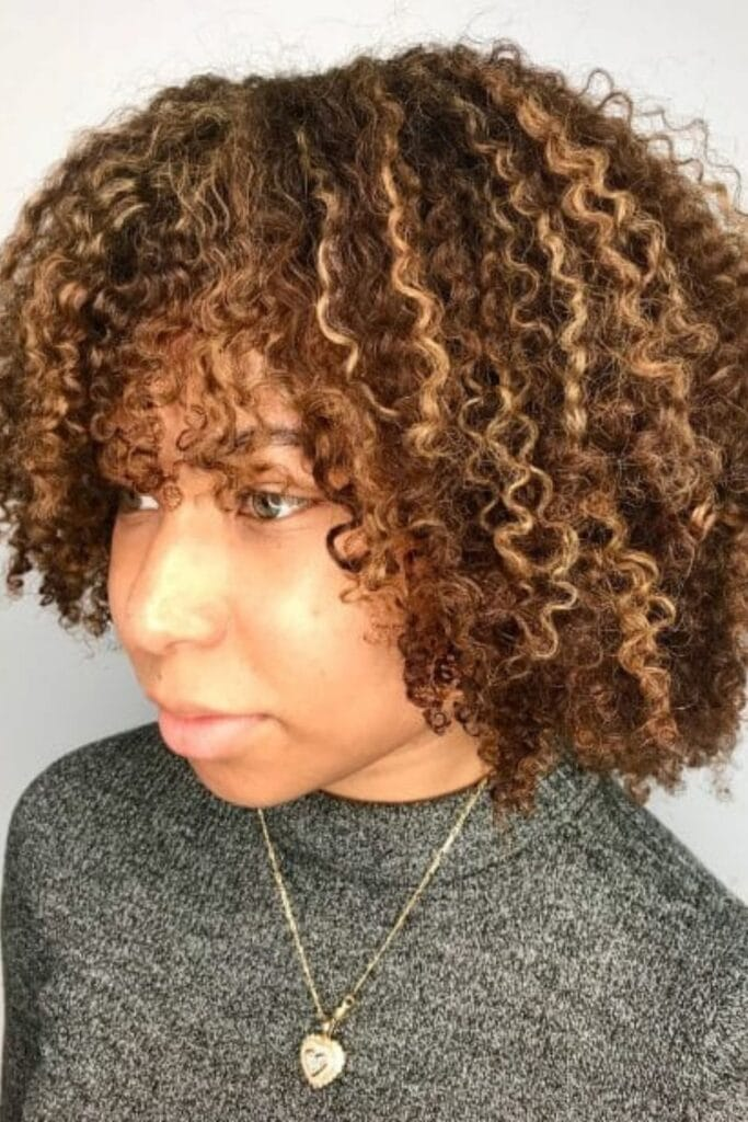 Dirty Blonde Highlights on Brown Curly Hair